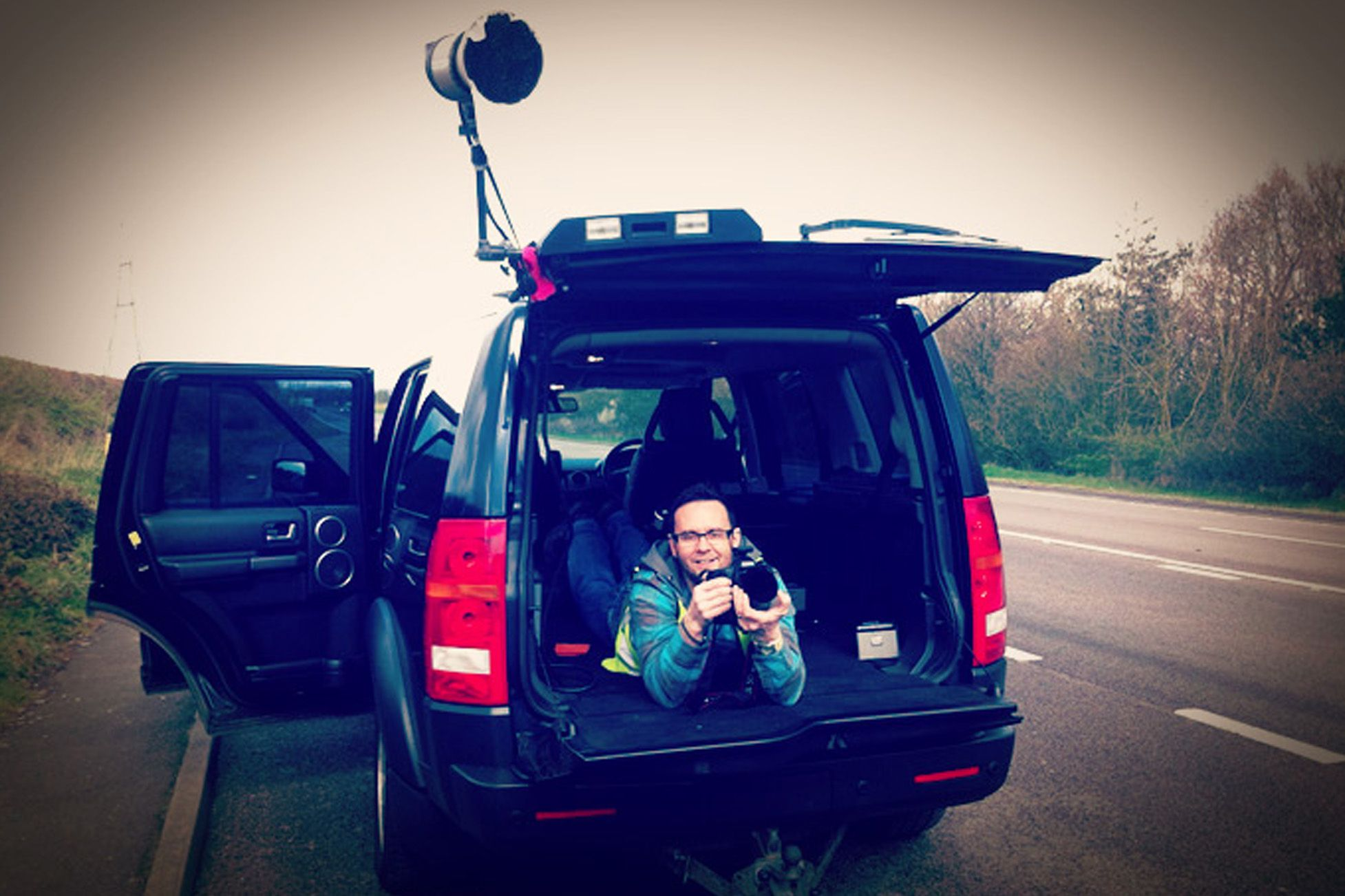 Just what is photographer Dave doing in the back of that 4x4? 10